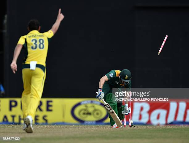 South Africa's Wayne Parnell is bowled by Australia's Josh Hazlewood during a Oneday International cricket match between South Africa and Australia...