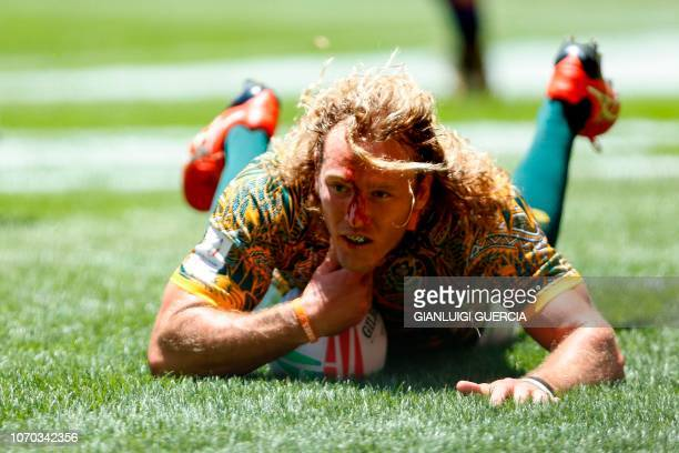 South Africa's Werner Kok scores a try during the quarter final between Scotland and South Africa on the second and last day of the Rugby Sevens...