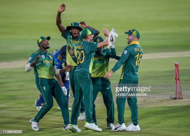South Africa's wicketkeeper Quinton de Kock celebrates with teammates after running out Sri Lankan batsman Kusal Mendis during the second one day...