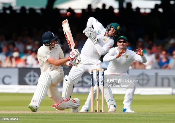 South Africas wicketkeeper Quinton de Kock reacts after Englands Captain Joe Root hits a shot on the first day of the first Test match between...