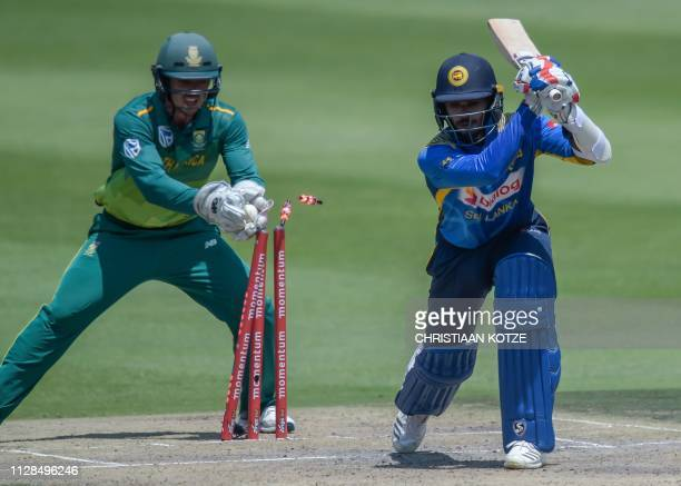 South Africa's wicketkeeper Quinton de Kock stumps Sri Lanka's Dhananjaya de Silva out for 39 runs during the first one day international cricket...
