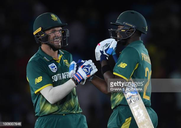 South Africa's Willem Mulder and Andile Phehlukwayo celebrate after South Africa won by four wickets in the second oneday international cricket match...