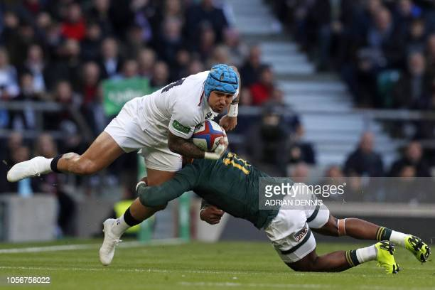 South Africa's wing Aphiwe Dyantyi tackles England's wing Jack Nowell during the international rugby union test match between England and South...