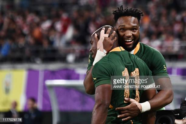South Africa's wing Makazole Mapimpi celebrates with South Africa's centre Lukhanyo Am after scoring a try during the Japan 2019 Rugby World Cup...