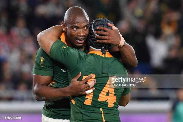 South Africa's wing Makazole Mapimpi is congratulated by South Africa's wing Cheslin Kolbe after scoring a try during the Japan 2019 Rugby World Cup...