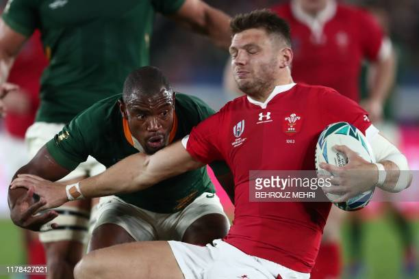 South Africa's wing Makazole Mapimpi tackles Wales' flyhalf Dan Biggar during the Japan 2019 Rugby World Cup semifinal match between Wales and South...