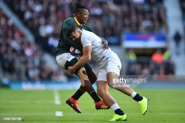 South Africa's wing Sibusiso Nkosi is tackled by England's wing Jonny May during the international rugby union test match between England and South...