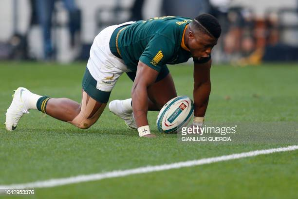 South Africa's winger Aphiwe Dyantyi prepares to score a try during the Rugby Championship match between South Africa and Australia at Nelson Mandela...