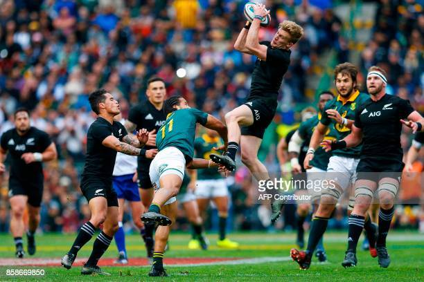 South Africa's winger Courtnall Skosan and New Zealand's flyhalf Damian Mckenzie go for the ball during the Rugby test match between South Africa and...