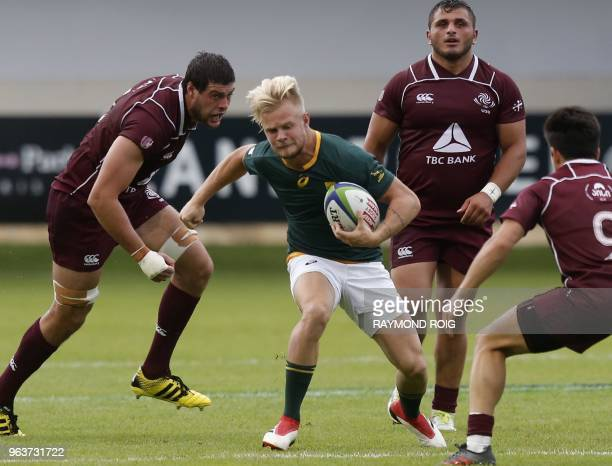 South Africa's winger Tyrone Green breaks away from Georgia's defence during the Under 20 Rugby union World Cup at the Aime Giral stadium in...