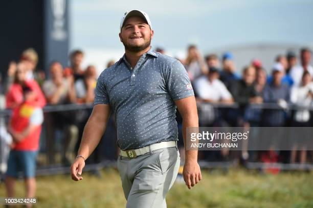 South Africa's Zander Lombard acknowledges the applause after holing his eagle approach on the 18th hole during his third round on day 3 of The 147th...