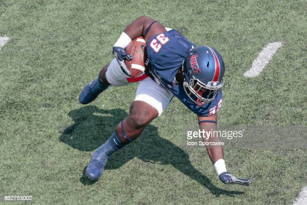 South Alabama Jaguars running back Tra Minter keeps his balance for a first down gain during the South Alabama Jaguars vs Idaho Vandals game at...