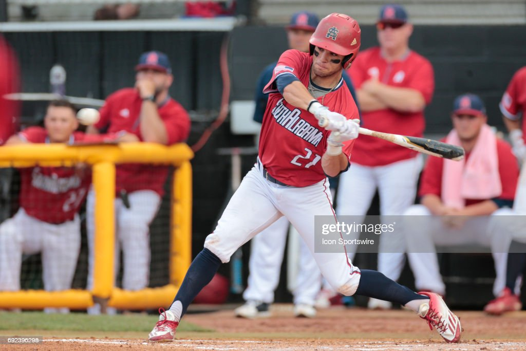 South Alabama outfielder Travis Swaggerty (21) gets a hit during an NCAA Division I Regional baseball game between the Mississippi State Bulldogs and the South Alabama Jaguars on June 04, 2017 at Pete Taylor Park, Hattiesburg, MS.