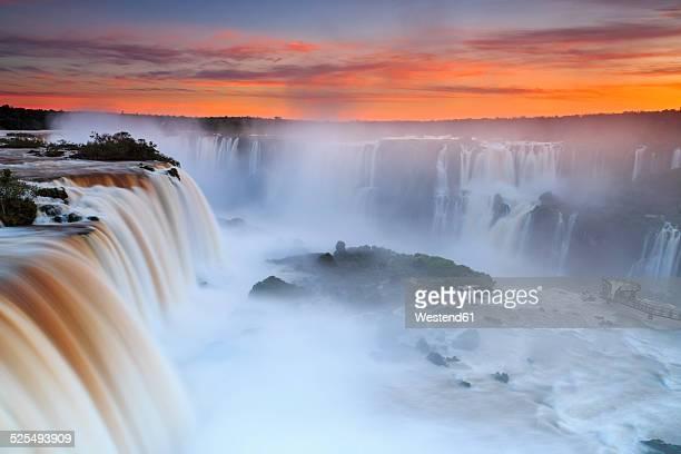 south america, argentina, brazil, iguazu national park, iguazu falls at sunset - イグアス滝 ストックフォトと画像