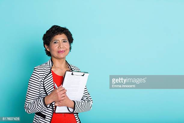 south american business woman holding notpad