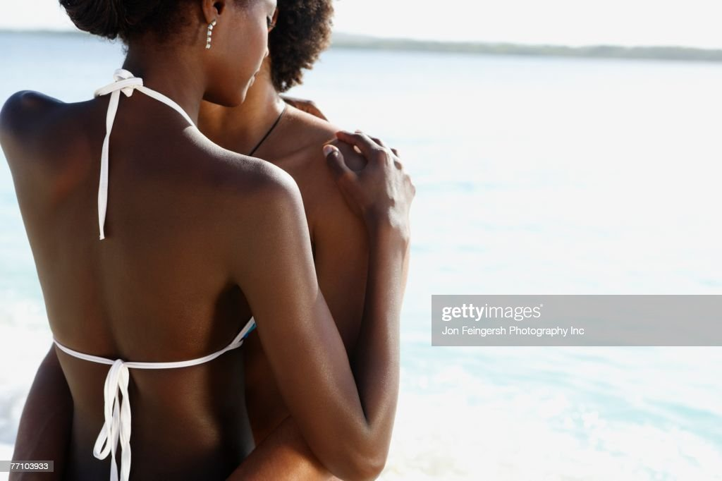 South American couple hugging in water : Stock Photo