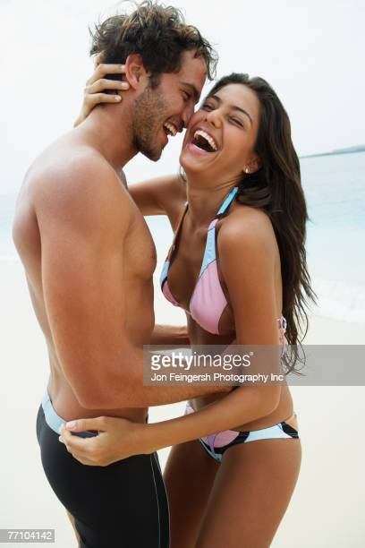 South American couple hugging