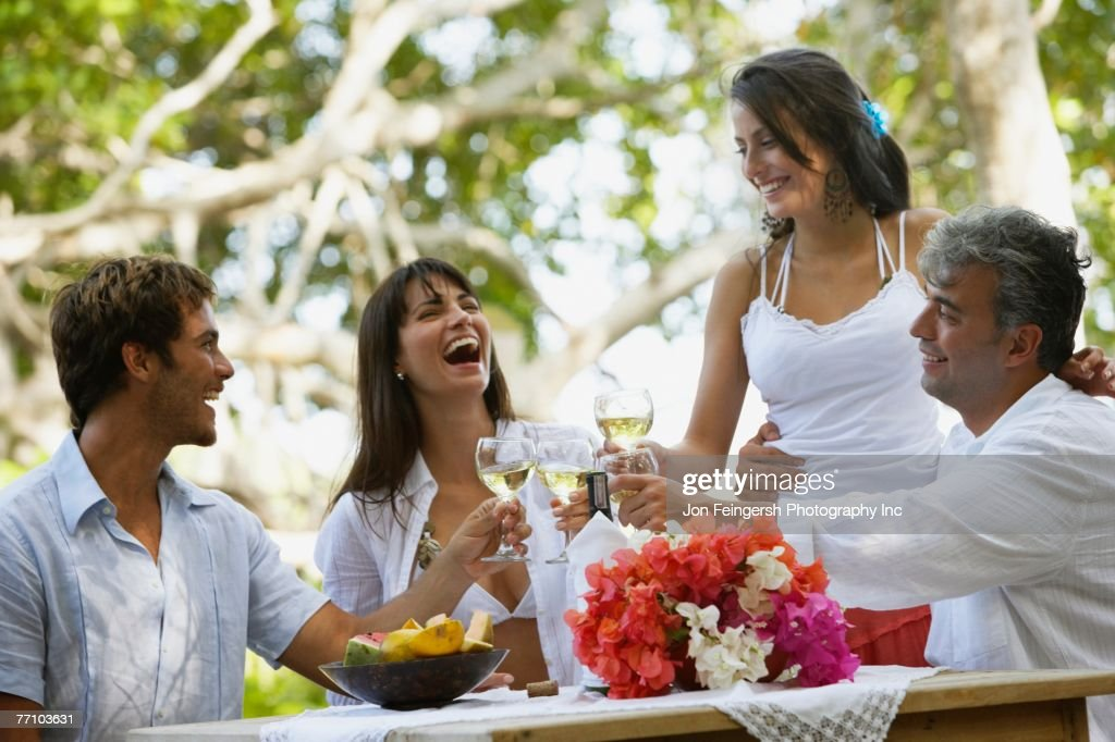 South American couples toasting with wine : Stock Photo