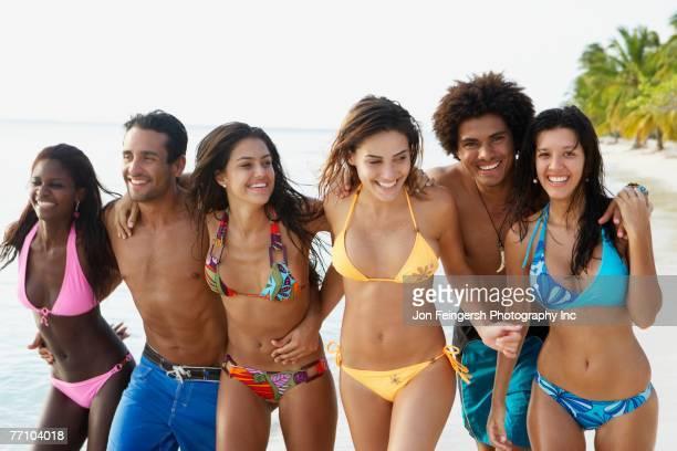 South American friends walking on beach