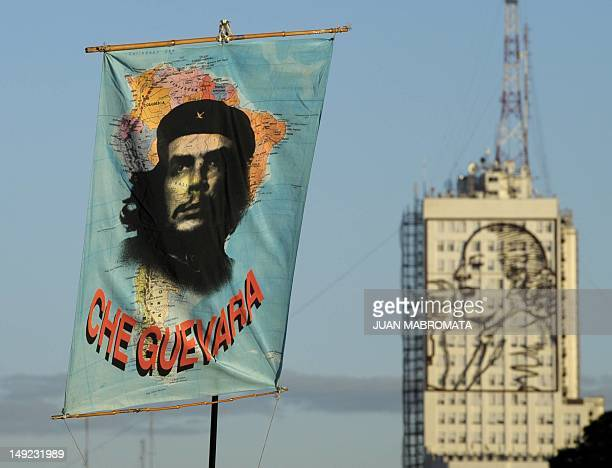 A South American map with the portrait of Argentineborn Cuban revolutionary leader Ernesto Che Guevara on it waves during a demonstration to support...