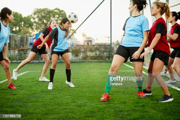 south american soccer player strikes a head shot after a corner kick. - corner kick stock pictures, royalty-free photos & images