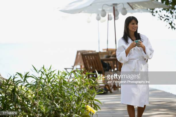 South American woman in spa bathrobe