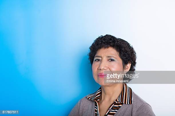 south american woman on blue background