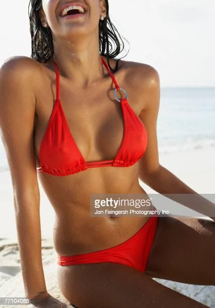 South American woman sitting on beach