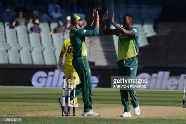 South Arica's Aiden Markram congratulates bowler Kagiso Rabada for taking the wicket of Australian batsman Alex Carey during the second one day...