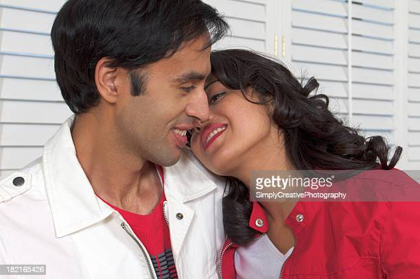 south asian couple in a warm embrace. - indian couples stock pictures, royalty-free photos & images