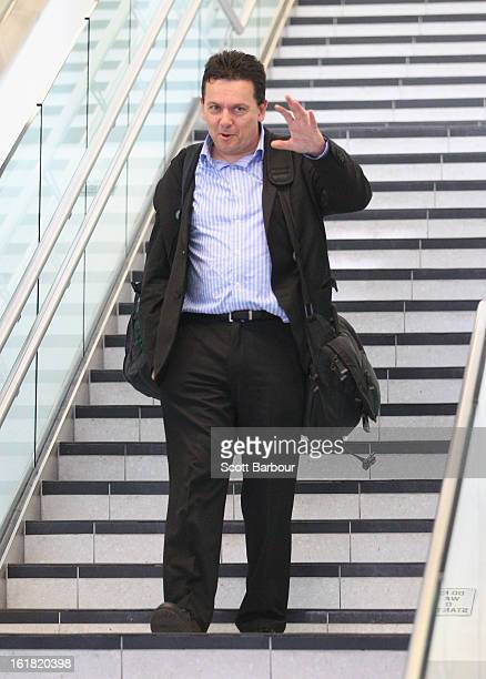 South Australian Federal Senator Nick Xenophon waves as he arrives at Adelaide Airport after his deportation from Malaysia on February 17 2013 in...