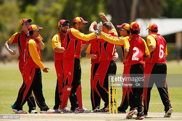 South Australian players celebrate a wicket against Western Australia during the 20415 Imparja Cup on February 10 2015 in Alice Springs Australia