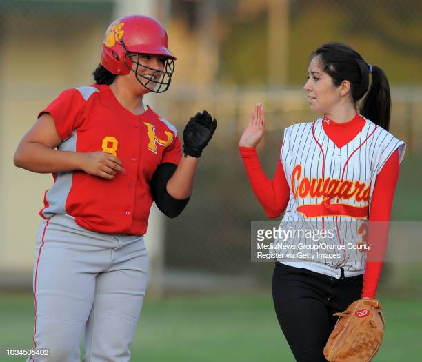 EL SEGUNDO 06/10/10 South Bay Athletic Club's annual Senior AllStar softball game Blue team's Jackie Delgado left is congratulated by her Hawthorne...