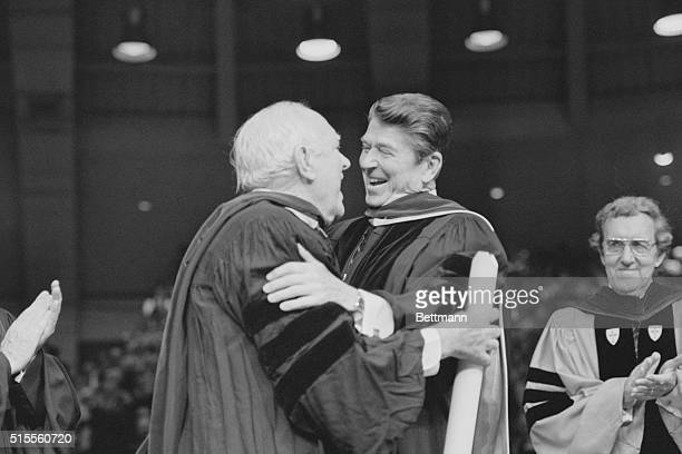 Class of '81 Old friends actor Pat O'Brien and President Ronald Reagan embrace May 17th as former Secretary of State Edmund Muskie watches at the...