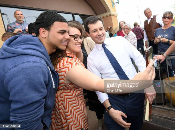 South Bend Indiana Mayor Pete Buttigieg poses for photos with supporters during a meetandgreet at Madhouse Coffee on April 8 2019 in Las Vegas Nevada...