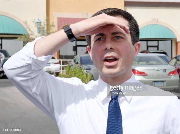 South Bend Indiana Mayor Pete Buttigieg reacts as he sees an overflow crowd waiting for him at a meetandgreet at Madhouse Coffee on April 8 2019 in...