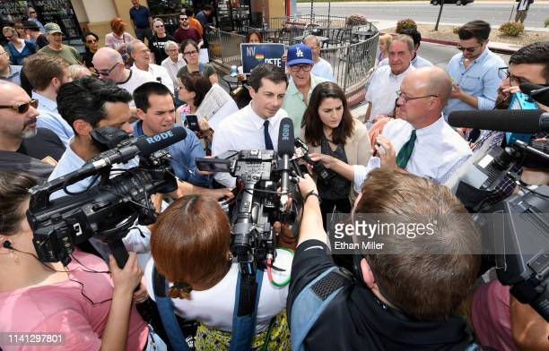 South Bend Indiana Mayor Pete Buttigieg talks to members of the media as he leaves a meetandgreet at Madhouse Coffee on April 8 2019 in Las Vegas...