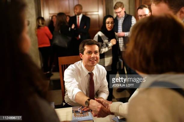 South Bend Indiana Mayor Pete Buttigieg who is exploring a 2020 presidential candidacy greets a guest as he signs copies of his book Shortest Way...