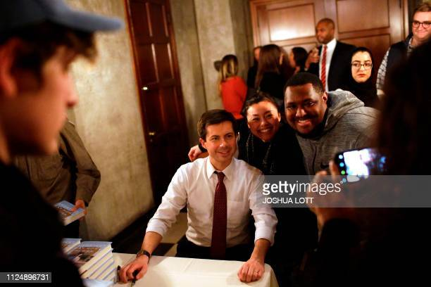 """South Bend, Indiana, Mayor Pete Buttigieg, who is exploring a 2020 presidential candidacy, takes a photo as he signs copies of his book """"Shortest Way..."""