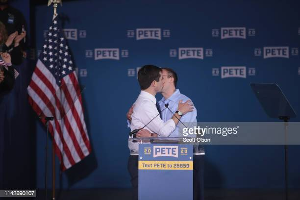 South Bend Mayor Pete Buttigieg kisses his husband Chasten Glezman announcing that he will be seeking the Democratic nomination for president during...