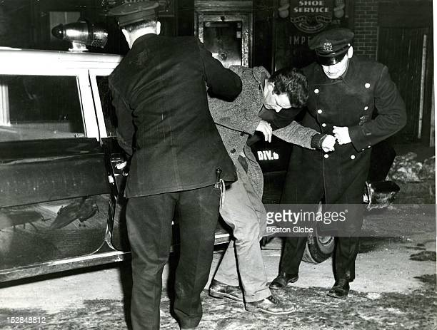 South Boston police hustle a man from Flood Sq hardware store alleging they found him inside at 130 am Police Sgt Herbert Rodday and patrolmen Norman...