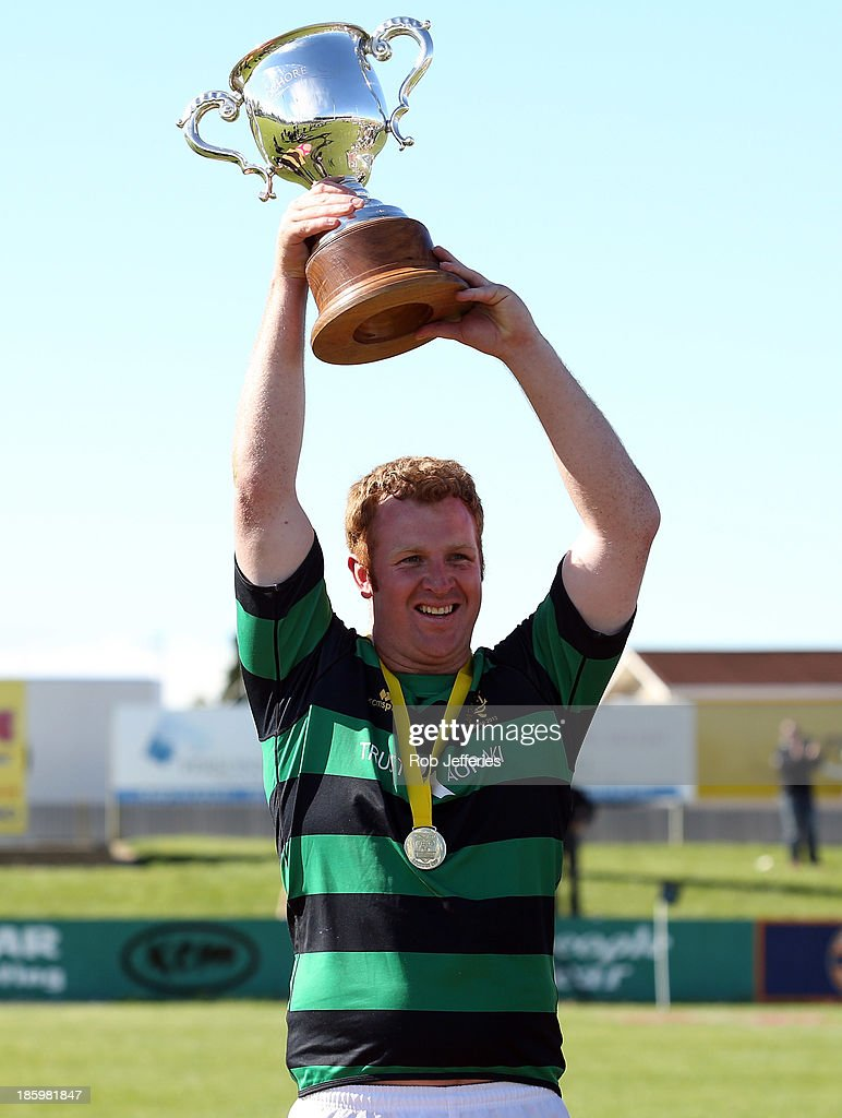 South Canterbury captain Andrew Scarlett holds aloft the Lochore Cup after defeating Buller in the final of the Lochore Cup Final match between South Canterbury and Buller at Alpine Energy Stadium on October 27, 2013 in Timaru, New Zealand.