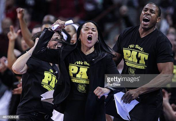 South Carolina coach Dawn Staley and assistant coaches Lisa Boyer and Darius Taylor react as South Carolina pulls to a 10point lead at the end of the...
