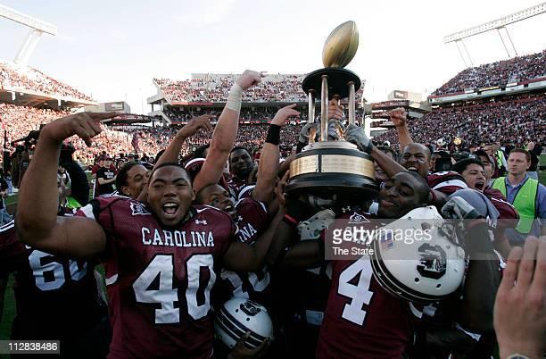 South Carolina Eric Norwood and Jason Barnes celebrate the Gamecocks 3417 victory over Clemson University at Williams Brice Stadium on Saturday...