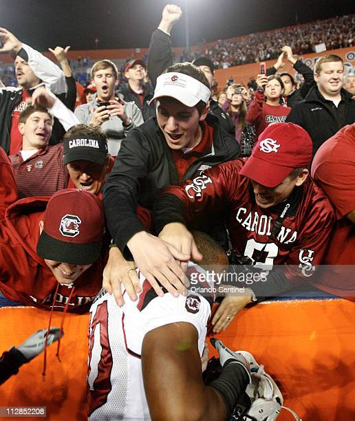 South Carolina fans mob tailback Brian Maddox while celebrating the Gamecocks' 3614 victory over the Florida Gators at Ben Hill Griffin Stadium in...