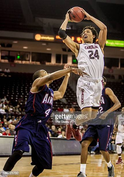 South Carolina forward Michael Carrera shoots over USC Aiken guard DeVontae Wright during an exhibition game at Colonial Life Arena in Columbia South...