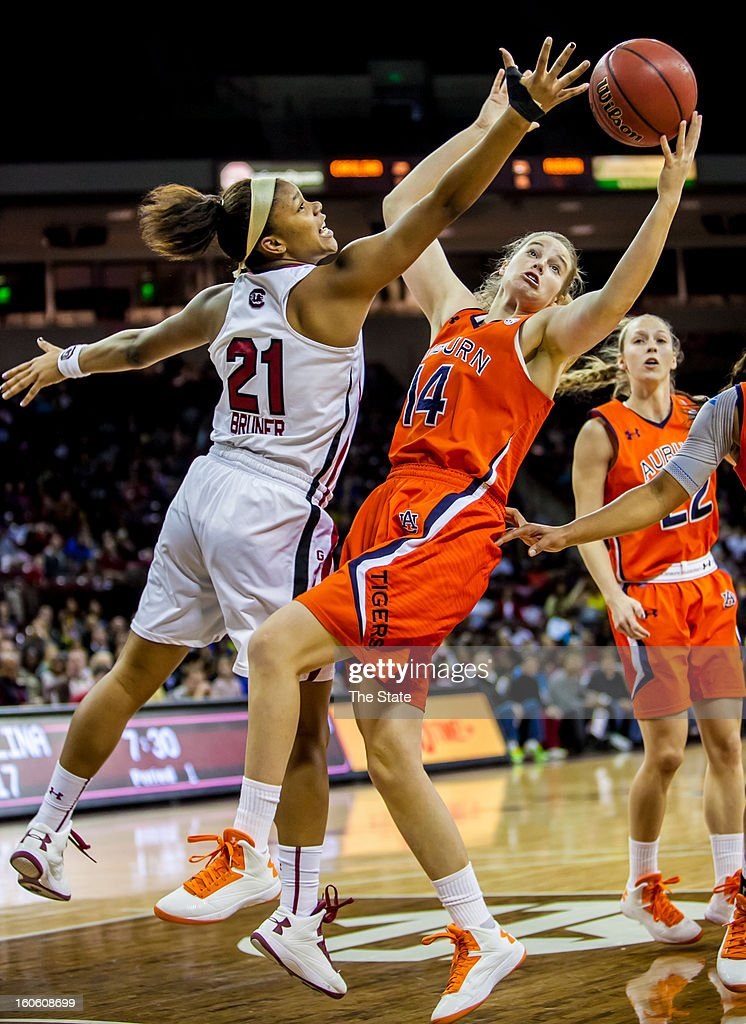 South Carolina Gamecocks forward Ashley Bruner (21) and Auburn Tigers guard/forward Blanche Alverson (14) battle for a rebound in the first half at Colonial Life Arena in Columbia, South Carolina, Sunday, February 3, 2013.