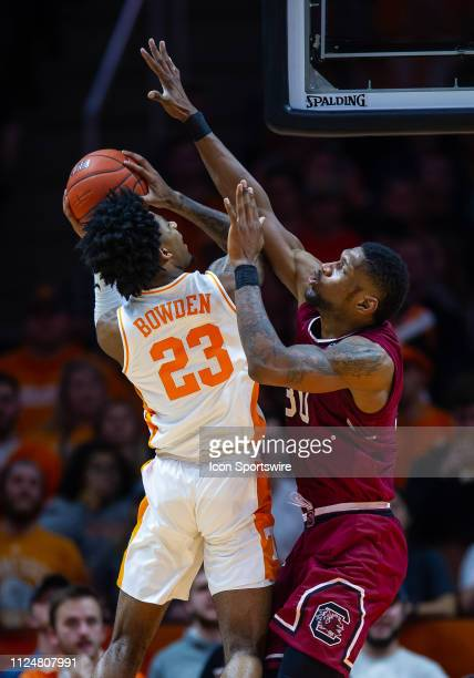 South Carolina Gamecocks forward Chris Silva attempts to block the shot of Tennessee Volunteers guard Jordan Bowden during a college basketball game...