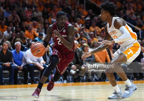 South Carolina Gamecocks forward Keyshawn Bryant drives around Tennessee Volunteers guard Jordan Bowden during a college basketball game between the...