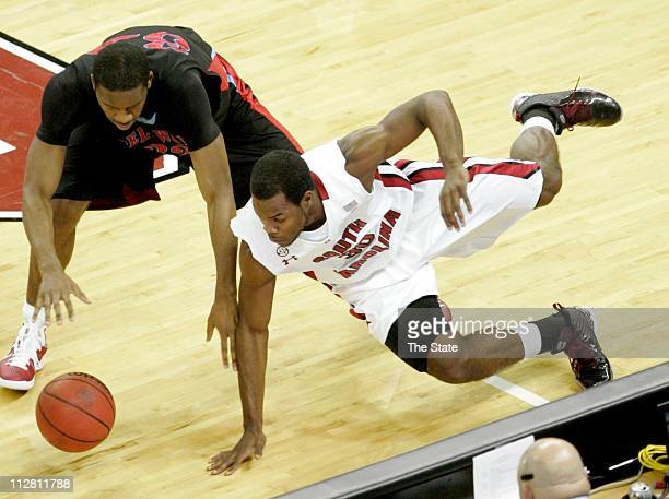 South Carolina Gamecocks forward Lakeem Jackson snags the ball from Delaware State Hornets forward Marques Oliver Wednesday December 1 at Colonial...